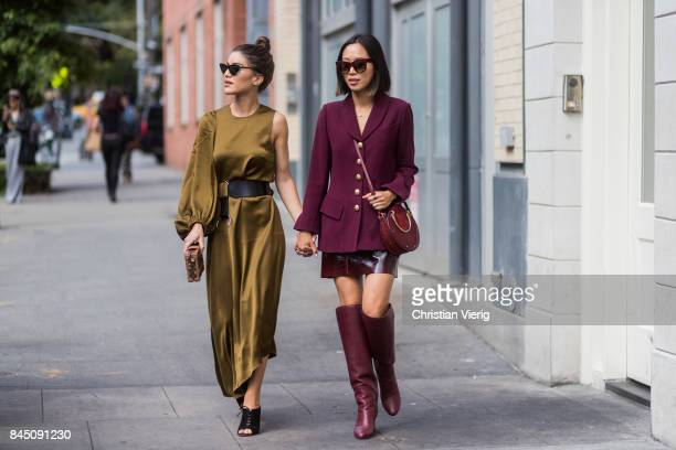 Camila Coelho and Aimee Song wearing bordeaux blazer jacket skirt boots seen in the streets of Manhattan outside Tibi during New York Fashion Week on...
