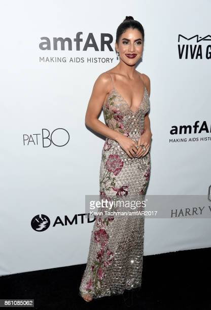 Camila Coelho at amfAR Los Angeles 2017 at Ron Burkle's Green Acres Estate on October 13 2017 in Beverly Hills Californi
