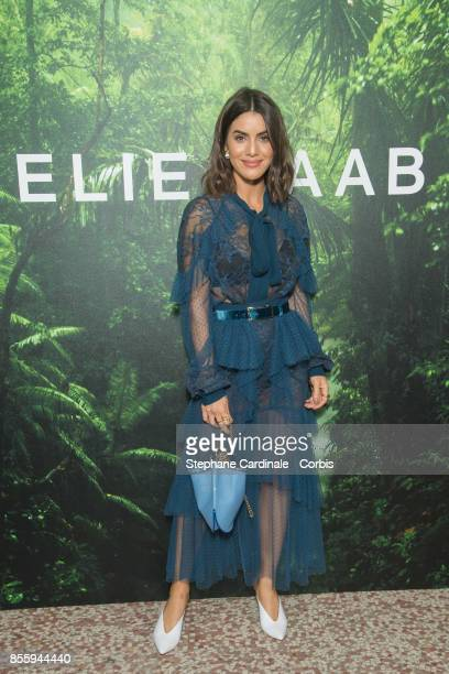 Camila Coelho attends the Elie Saab show as part of the Paris Fashion Week Womenswear Spring/Summer 2018 at on September 30 2017 in Paris France