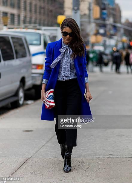 Camila Coelho is wearing a blue Michael Kors wool coat Elena Ghisellini bag and Dior boots seen outside Michael Kors during New York Fashion Week...