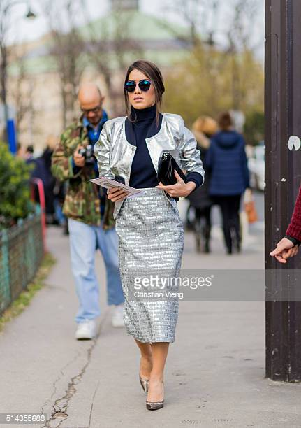 Camila Coelho is wearing a silver skirt and blazer jacket from Chanel outside Chanel during the Paris Fashion Week Womenswear Fall/Winter 2016/2017...