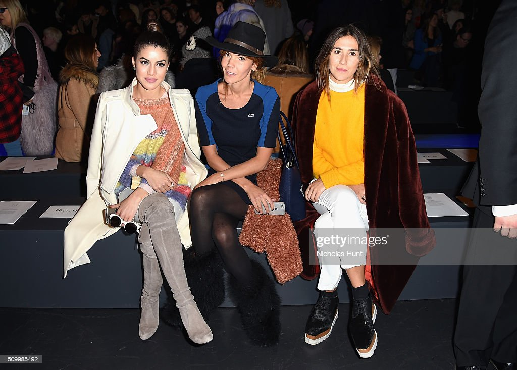 Camila Coelho, Titi Vasquez, and Lucia Vilarino attend the Herve Leger By Max Azria Fall 2016 fashion show during New York Fashion Week: The Shows at The Arc, Skylight at Moynihan Station on February 13, 2016 in New York City.