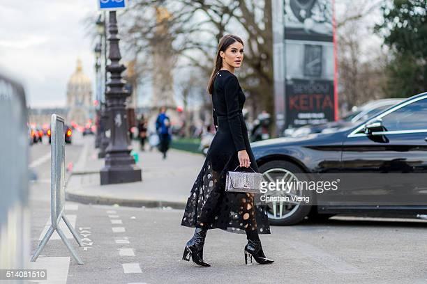 Camila Coelho wearing a black dress otuside Akris during the Paris Fashion Week Womenswear Fall/Winter 2016/2017 on March 6 2016 in Paris France
