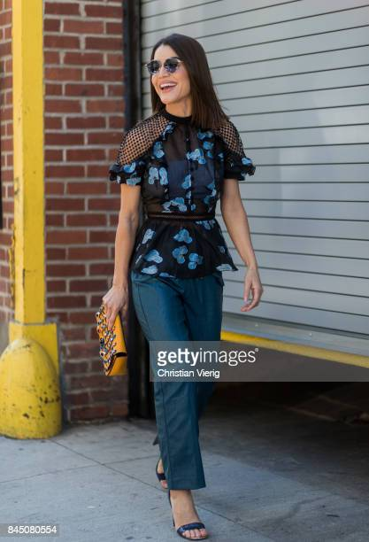 Camila Coelho wearing a transparent top seen in the streets of Manhattan outside SelfPortrait during New York Fashion Week on September 9 2017 in New...