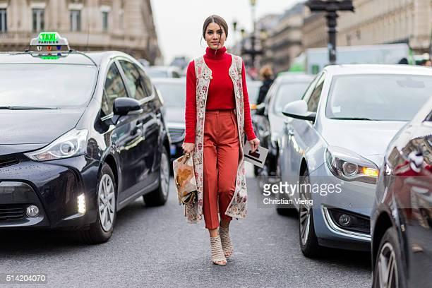 Camila Coelho wearing Prada heel sandals a Chloe bag Cecilia Prado vest with floral print a red turtleneck jumper and pants outside Stella McCartney...