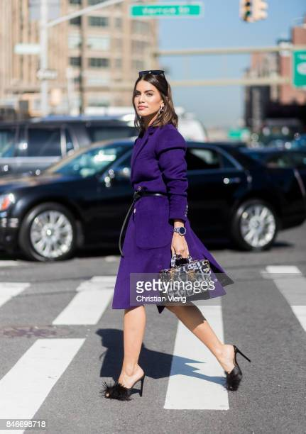 Camila Coelho wearing purple coat seen in the streets of Manhattan outside Michael Kors during New York Fashion Week on September 13 2017 in New York...