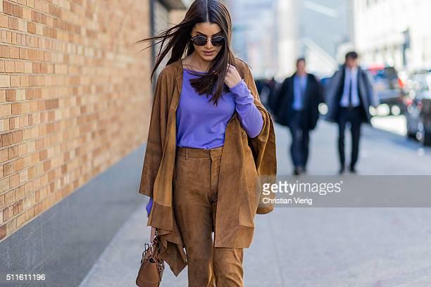 Camila Coelho wearing Ralph Lauren pants jacket and bag seen outside Ralph Lauren during New York Fashion Week Women's Fall/Winter 2016 on February...