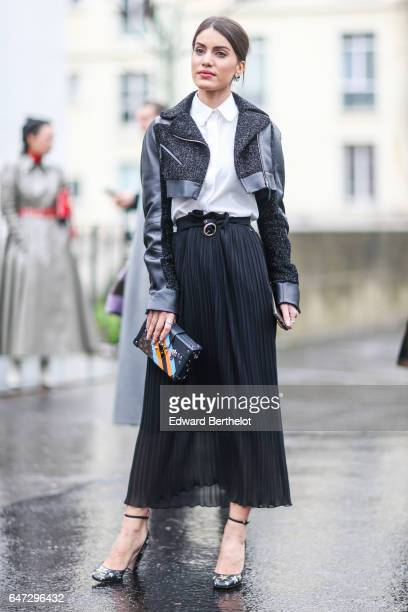 Camila Coelho wears a jacket a white top and a black skirt outside the Rochas show during Paris Fashion Week Womenswear Fall/Winter 2017/2018 on...