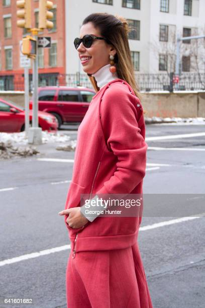 Camila Coutinho is seen at Spring Studios outside the Lacoste show wearing pink cotton over sized sweater and three quarter length pleated skirt...