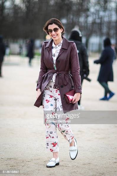 Camila Coutinho is wearing a Patbo coat a Fendi bag Tory Burch pants and Louis Vuitton shoes after the Carven show during Paris Fashion Week...