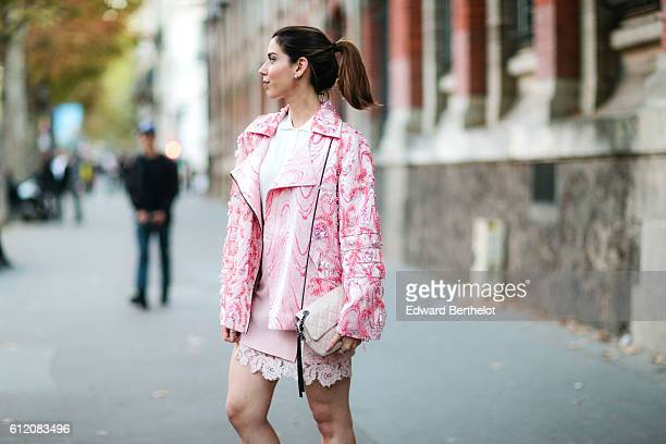 Camila Coutinho is wearing a pink outfit and a Chanel bag outside the Galliano show during Paris Fashion Week Spring Summer 2017 on October 2 2016 in...