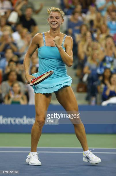 Camila Giorgi of Italy celebrates match point during her wwomen's singles third round mac against Caroline Wozniacki of Denmark on Day Six of the...