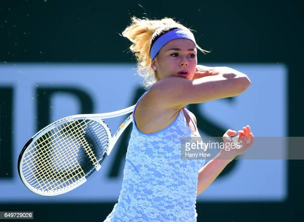 Camila Giorgi of Italy hits a forehand in her loss to Johanna Larsson of Sweden during the BNP Parisbas Open at Indian Wells Tennis Garden on March 8...