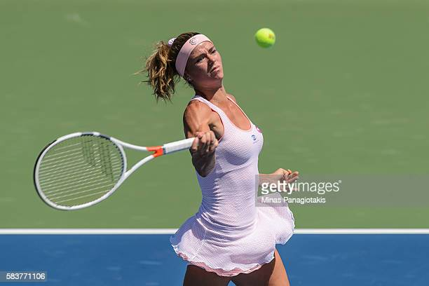 Camila Giorgi of Italy hits a return against Roberta Vinci of Italy during day three of the Rogers Cup at Uniprix Stadium on July 27 2016 in Montreal...