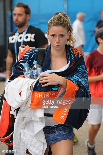 Camila Giorgi of Italy leaves the court after her match against Angelique Kerber of Germany was suspended due to rain during day two of the 2016...