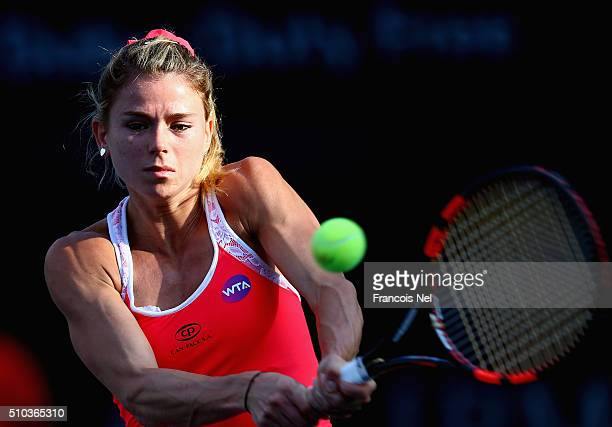 Camila Giorgi of Italy plays a backhand in her match against Andrea Petkovic of Germany during day one of the WTA Dubai Duty Free Tennis Championship...