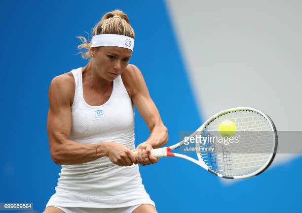 Camila Giorgi of Italy plays a backhand in her match against Elina Svitlona of Ukraine during day four of the Aegon Classic at Edgbaston Priory Club...
