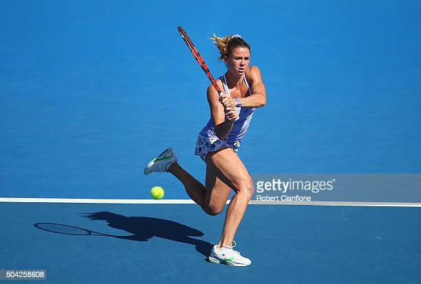 Camila Giorgi of Italy plays a backhand in the women's singles match against Zarina Diyas of Kazakhstan during day one of 2016 Hobart International...