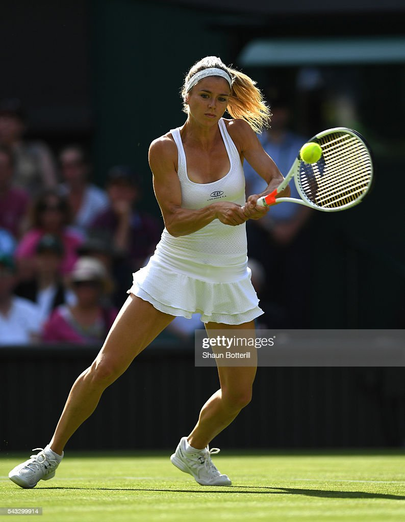 <a gi-track='captionPersonalityLinkClicked' href=/galleries/search?phrase=Camila+Giorgi&family=editorial&specificpeople=7865503 ng-click='$event.stopPropagation()'>Camila Giorgi</a> of Italy plays a backhand shot during the Ladies Singles first round match against Gabrine Muguruza of Spain of Italy on day one of the Wimbledon Lawn Tennis Championships at the All England Lawn Tennis and Croquet Club on June 27th, 2016 in London, England.