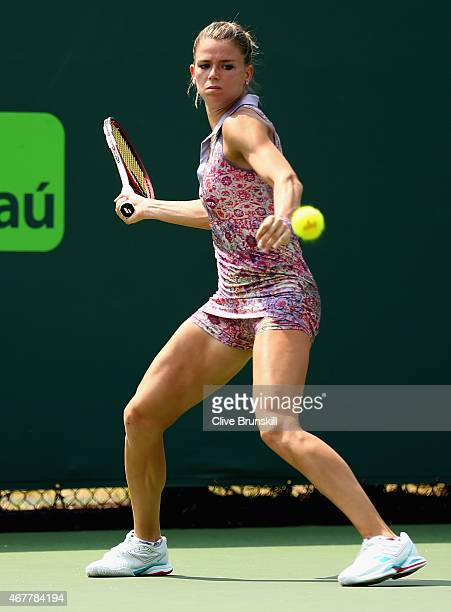 Camila Giorgi of Italy plays a forehand against Alison Van Utytvanck of Belgium in their second round match during the Miami Open Presented by Itau...