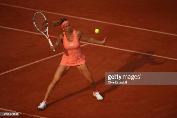 Camila Giorgi of Italy plays a forehand during the ladies singles first round match against Oceane Dodin of France on day one of the 2017 French Open...