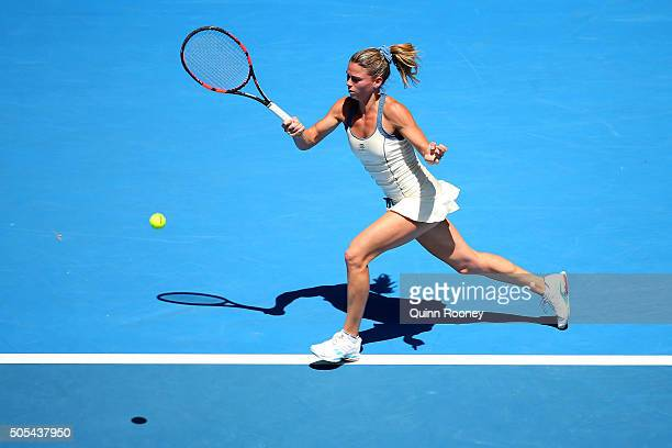 Camila Giorgi of Italy plays a forehand in her first round match against Serena Williams of the United States during day one of the 2016 Australian...