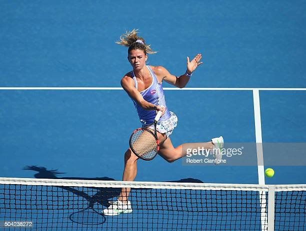Camila Giorgi of Italy plays a forehand in the women's singles match against Zarina Diyas of Kazakhstan during day one of 2016 Hobart International...