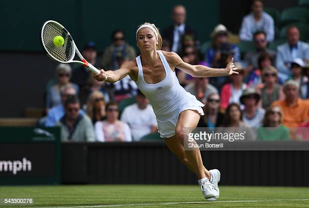 Camila Giorgi of Italy plays a forehand shot during the Ladies Singles first round match against Gabrine Muguruza of Spain of Italy on day one of the...
