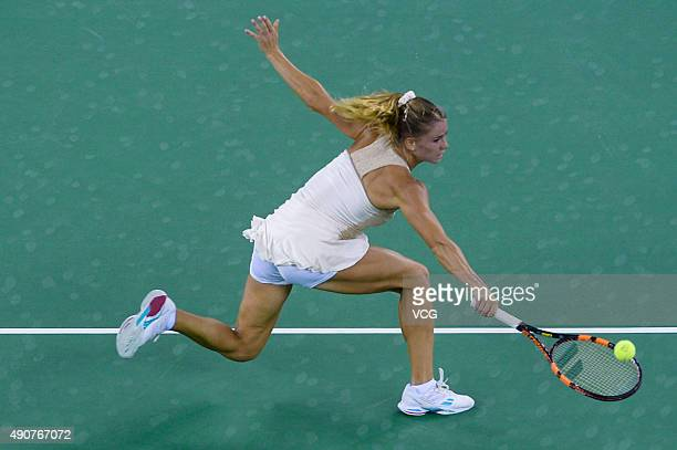Camila Giorgi of Italy returns a shot against Angelique Kerber of Germany during day four of 2015 Dongfeng Motor Wuhan Open at Optics Valley...