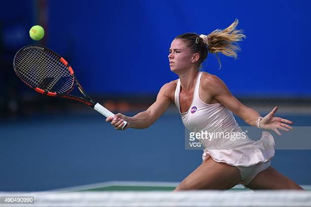 Camila Giorgi of Italy returns a shot against Belinda Bencic of Switzerland during day three of the 2015 Wuhan Open at Optics Vally International...