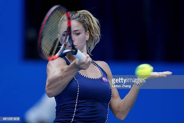 Camila Giorgi of Italy returns a shot against Timea Bacsinszky of Switzerland during the day one of the 2015 China Open at the China National Tennis...