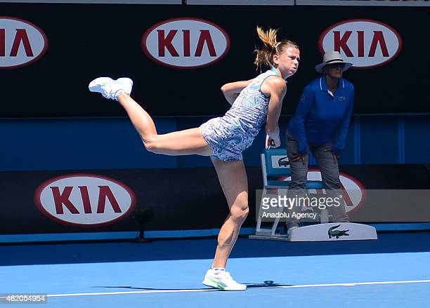 Camila Giorgi of Italy returns a shot against Venus Williams of the US during their third round match at the Australian Open tennis tournament at...