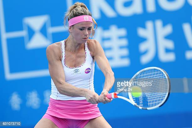Camila Giorgi of Italy returns a shot during the semi final match against Alison Riske of United States during Day 6 of 2017 WTA Shenzhen Open at...
