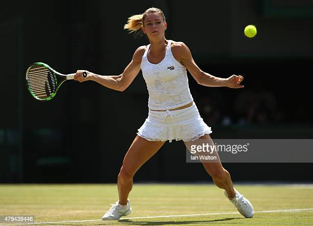 Camila Giorgi of Italy returns a shot in her Ladies' Singles Third Round match against Caroline Wozniacki of Denmark during day six of the Wimbledon...