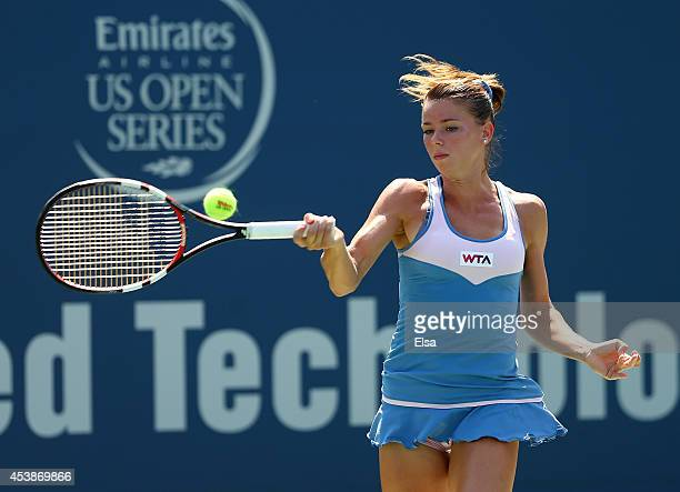Camila Giorgi of Italy returns a shot to Caroline Wozniacki of Denmark during the Connecticut Open at the Connecticut Tennis Center at Yale on August...