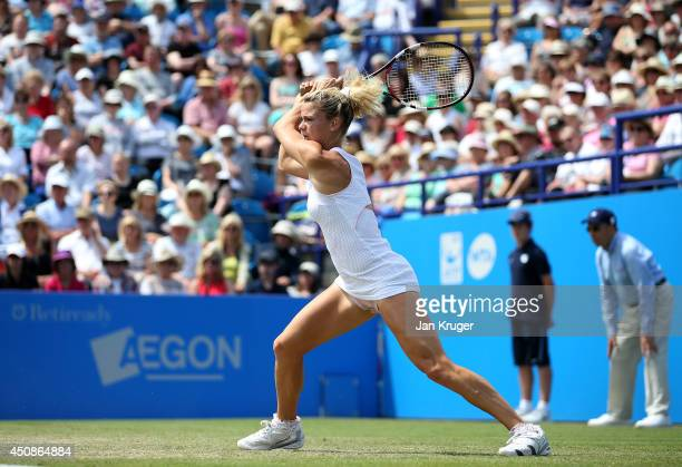 Camila Giorgi of Italy returns against Caroline Wozniacki of Denmark during their singles match on day six of the Aegon International at Devonshire...