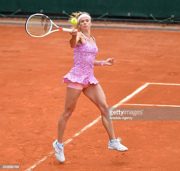 Camila Giorgi of Italy returns the ball during women's single first round match against Alize Lim of France at the French Open tennis tournament at...