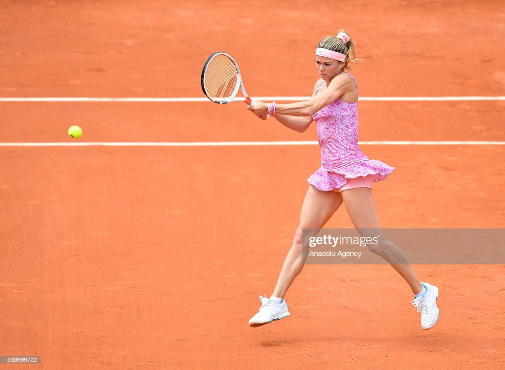Camila Giorgi (C) of Italy returns the ball during women's single first round match against Alize Lim of France at the French Open tennis tournament at Roland Garros in Paris, France on May 24, 2016.