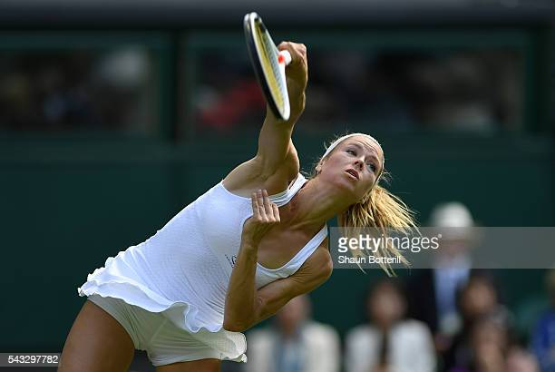 Camila Giorgi of Italy serves during the Ladies Singles first round match against Gabrine Muguruza of Spain on day one of the Wimbledon Lawn Tennis...