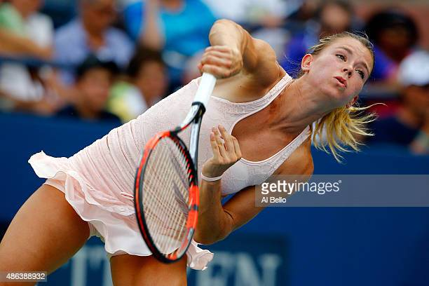Camila Giorgi of Italy serves to Sabine Lisicki of Germany during their Women's Singles Second Round match on Day Four of the 2015 US Open at the...