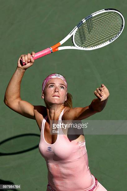 Camila Giorgi of Italy serves to Samantha Stosur of Australia during her first round Women's Singles match on Day Two of the 2016 US Open at the USTA...