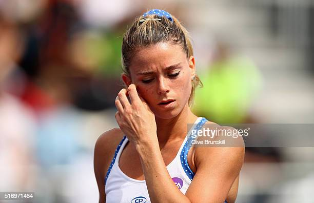 Camila Giorgi of Italy shows her dejection during her straight sets defeat in her first round match against Madison Brengle of the United States...