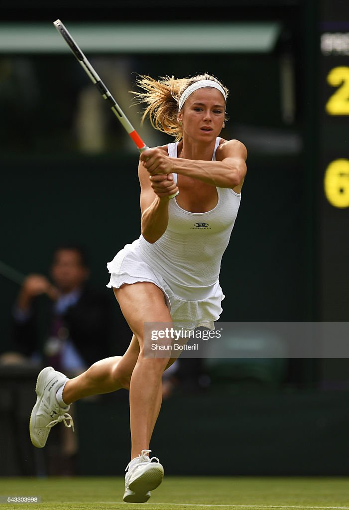 <a gi-track='captionPersonalityLinkClicked' href=/galleries/search?phrase=Camila+Giorgi&family=editorial&specificpeople=7865503 ng-click='$event.stopPropagation()'>Camila Giorgi</a> of Italy stretches for the ball during the Ladies Singles first round match against Gabrine Muguruza of Spain of Italy on day one of the Wimbledon Lawn Tennis Championships at the All England Lawn Tennis and Croquet Club on June 27th, 2016 in London, England.