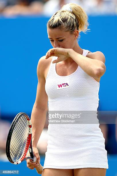 Camila Giorgi of Italy wipes her face between points while playing Caroline Wozniacki of Denmark during the Aegon International at Devonshire Park on...