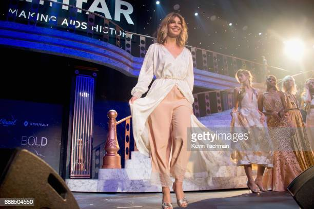 Camila Morrone walks the runway at the amfAR Gala Cannes 2017 at Hotel du CapEdenRoc on May 25 2017 in Cap d'Antibes France