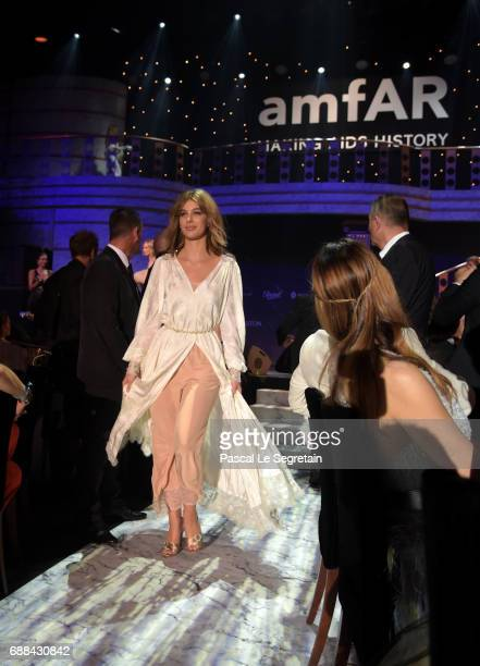 Camila Morrone walks the runway in the fashion show during the amfAR Gala Cannes 2017 at Hotel du CapEdenRoc on May 25 2017 in Cap d'Antibes France