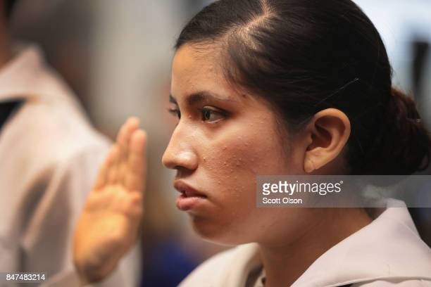 Camila Tenorio who has lived in the United States since she was 18 months old and is currently serving in the US Navy takes the Oath of Allegiance to...