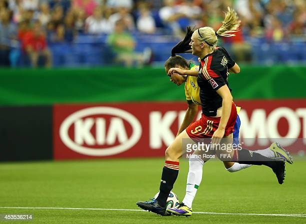 Camila#4 of Brazil and Pauline Bremer of Germany battle for the ball during the FIFA U20 Women's World Cup 2014 group B match between Brazil and...