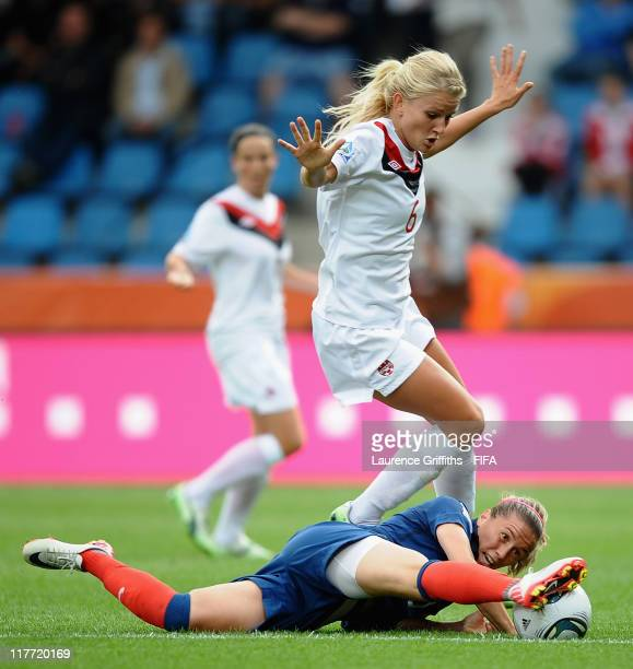 Camile Abily of France battles with Kaylyn Kyle of Canada during the FIFA Women's World Cup 2011 Group A match between Canada and France at the Fifa...