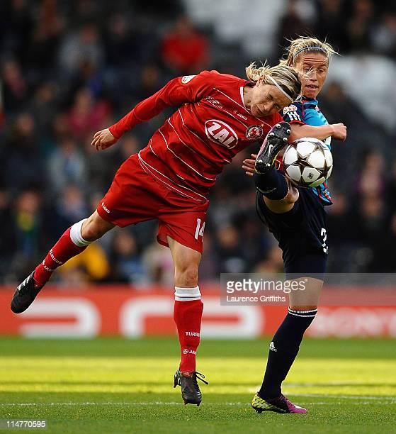 Camile Abily of Lyon battles with Jennifer Zietz of Turbine Potsdam during the UEFA Women's Champions League Final between Lyon and Turbine Potsdam...